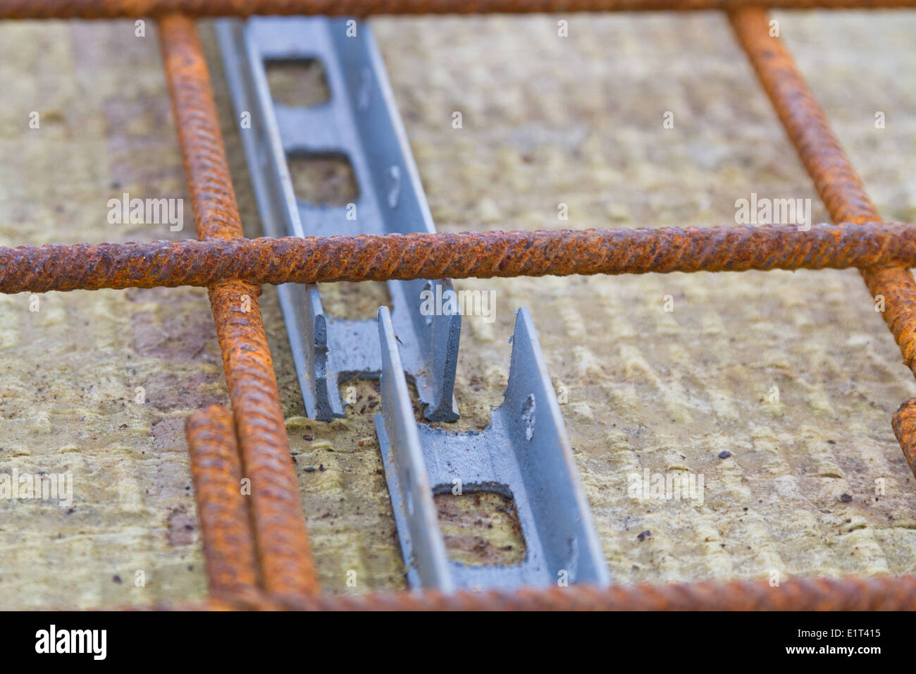Plastic spacers used with reinforcement for concrete floors and beams - Stock Image