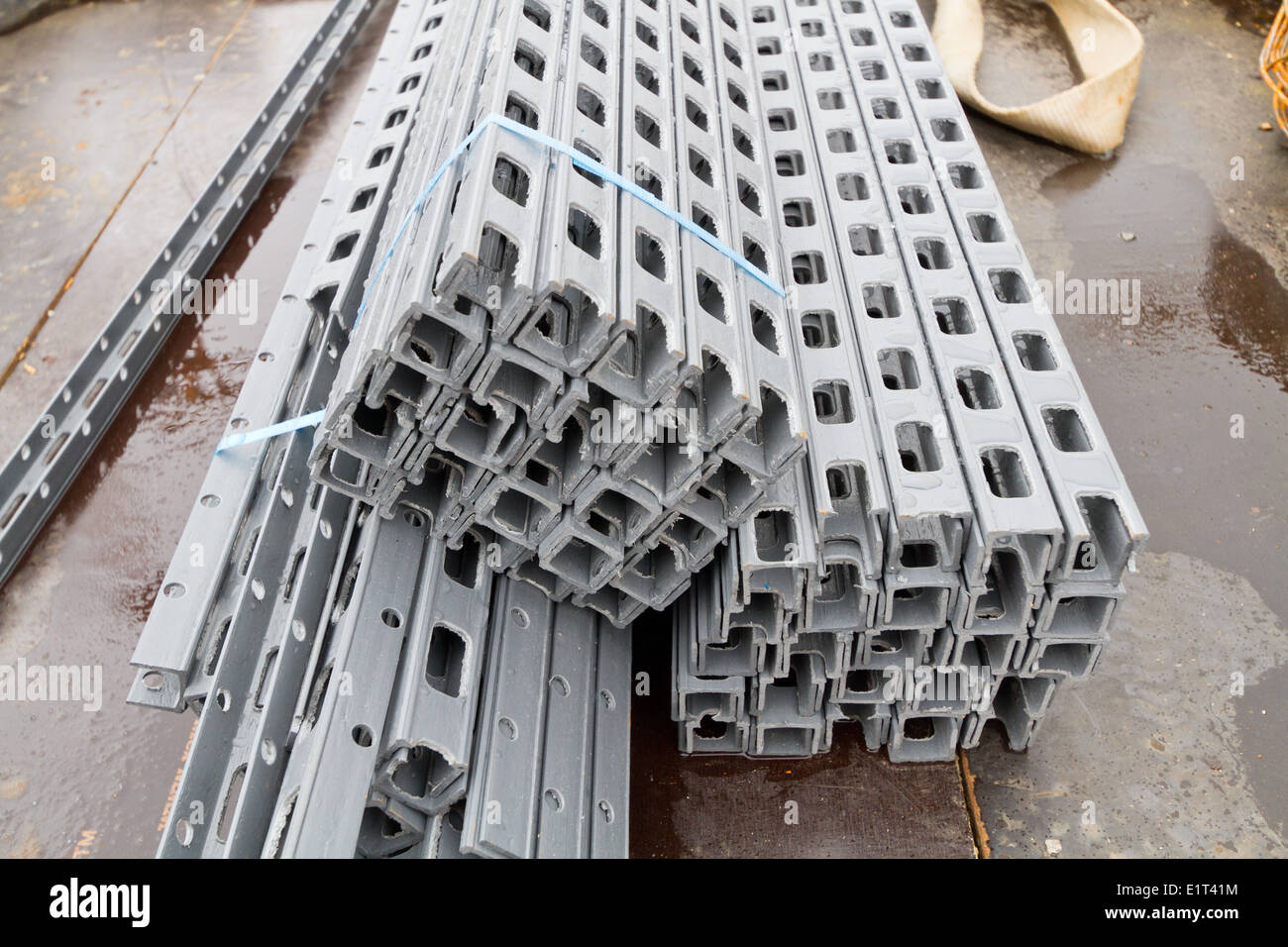 Plastic spacers in a bundle on a building site in Denmark - used with reinforcement for concrete floors and beams - Stock Image