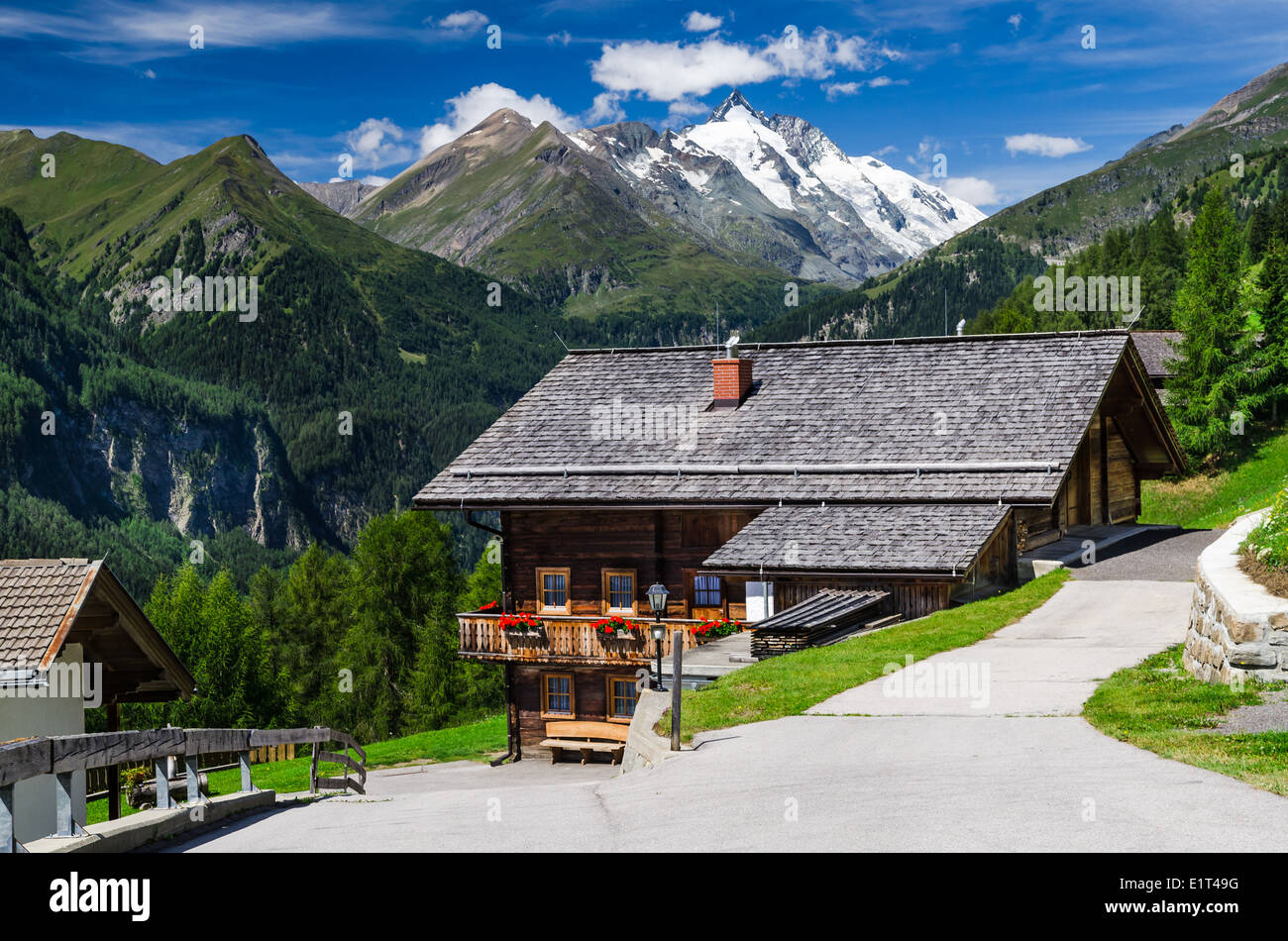 Rural landscape in Tirol Alps with the highest mountain from Austria in background, Grossglockner (3797 m. elevation) - Stock Image
