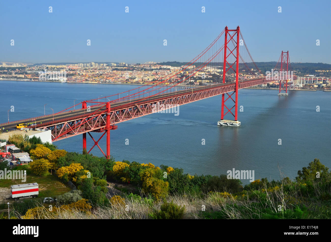 The 25 de Abril Bridge is a suspension bridge connecting the city of Lisbon to the municipality of Almada, over Stock Photo