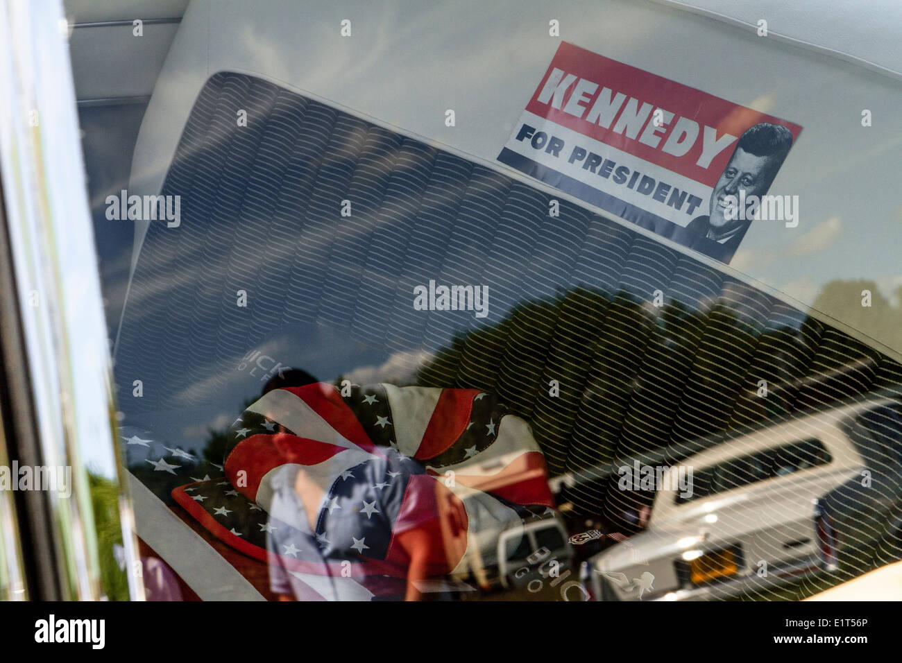 'Kennedy For President' campaign sticker in back of American car at classic car show - Stock Image