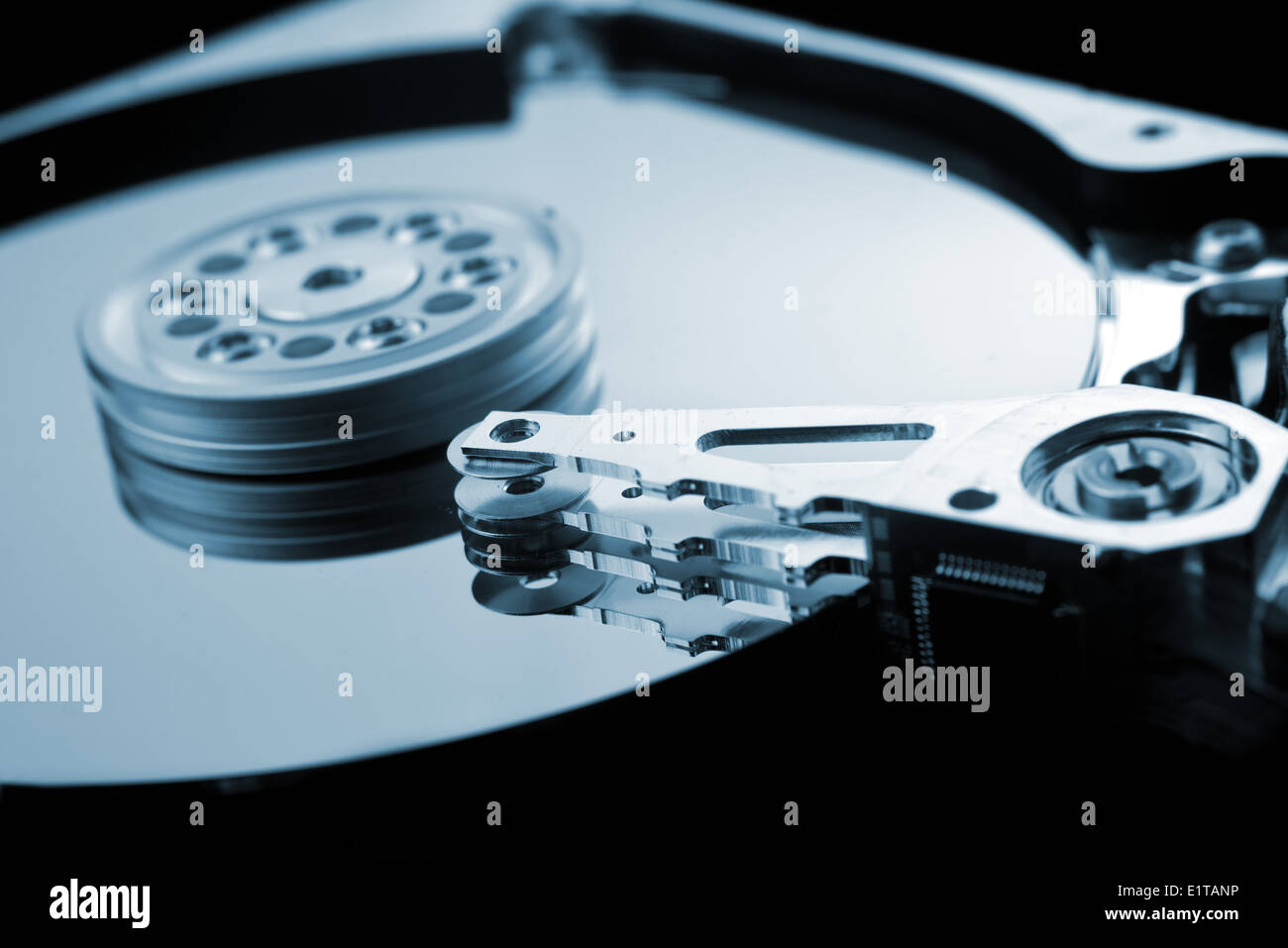 Computer hard disk close up detail with selective focus and shallow depth of field. Computer hardware, data storage. - Stock Image