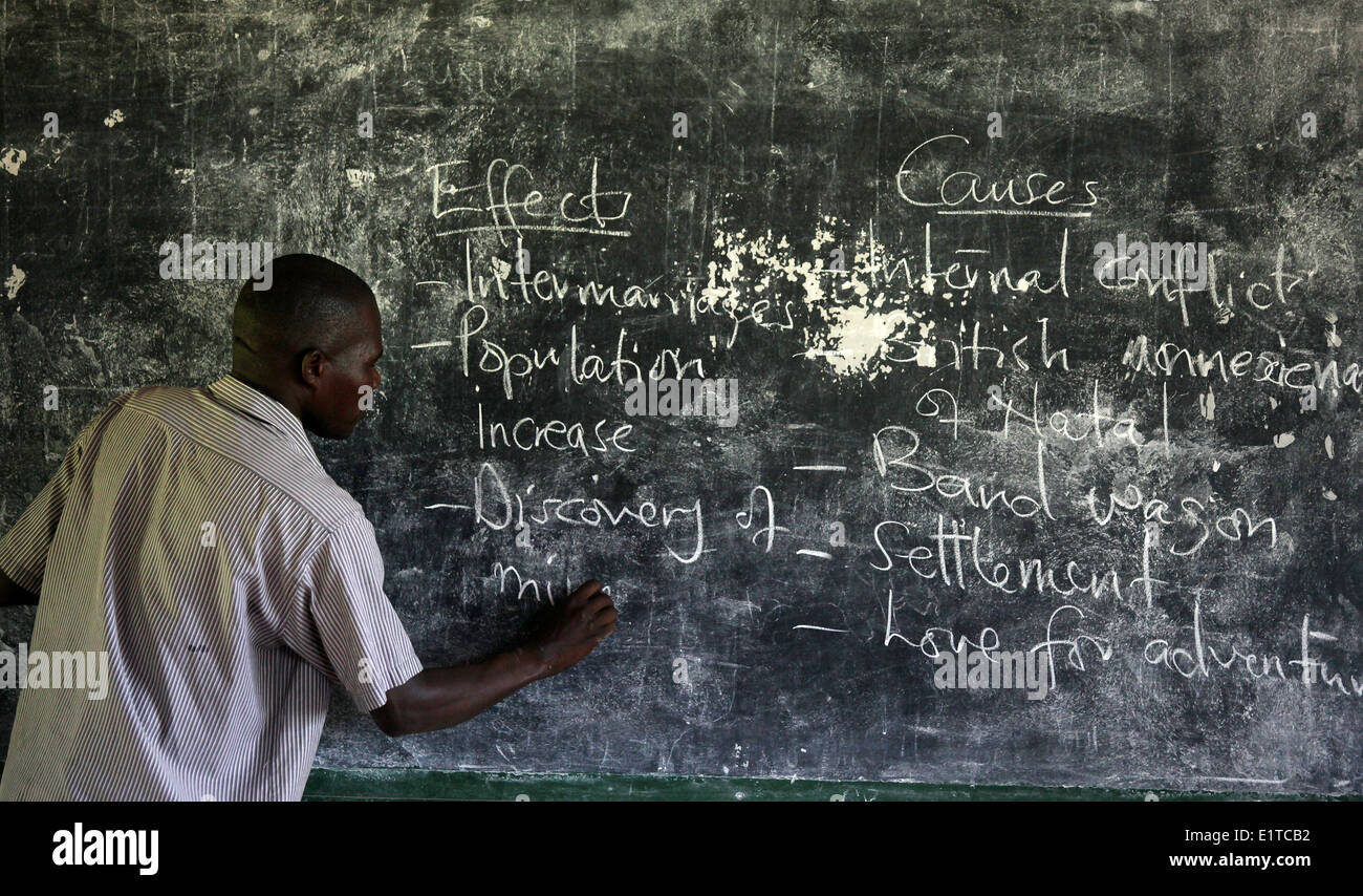 A teacher takes his class at a NGO funded school in the Nakasongola region of Uganda - Stock Image