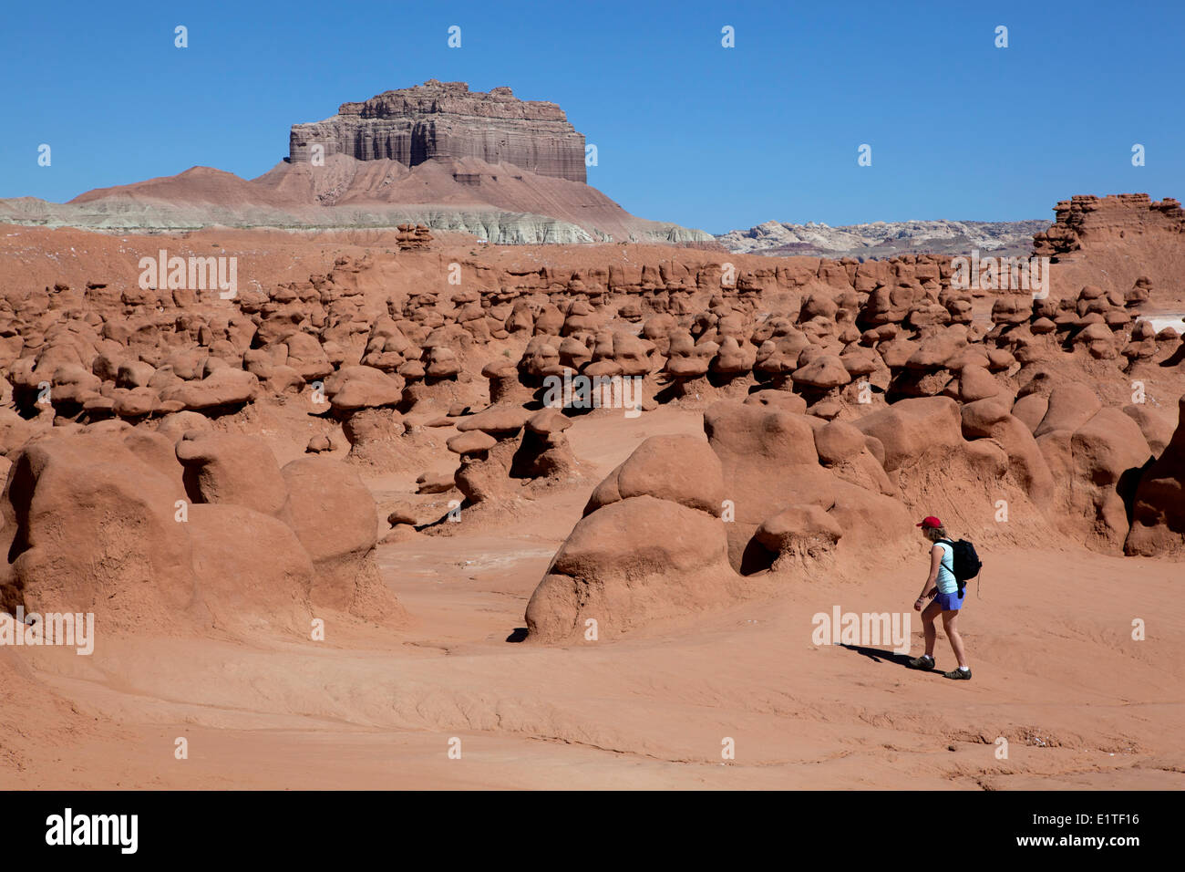 Hiker in Goblin Valley State Park, San Rafael Swell, Emery County, Utah, United States of America - Stock Image