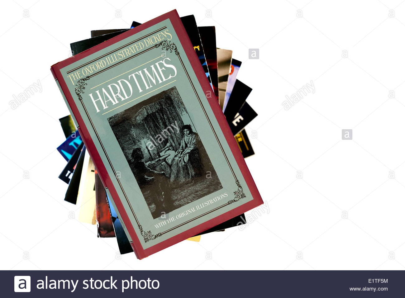 Charles Dickens novel, Hard Times, hardback title stacked used books, England - Stock Image