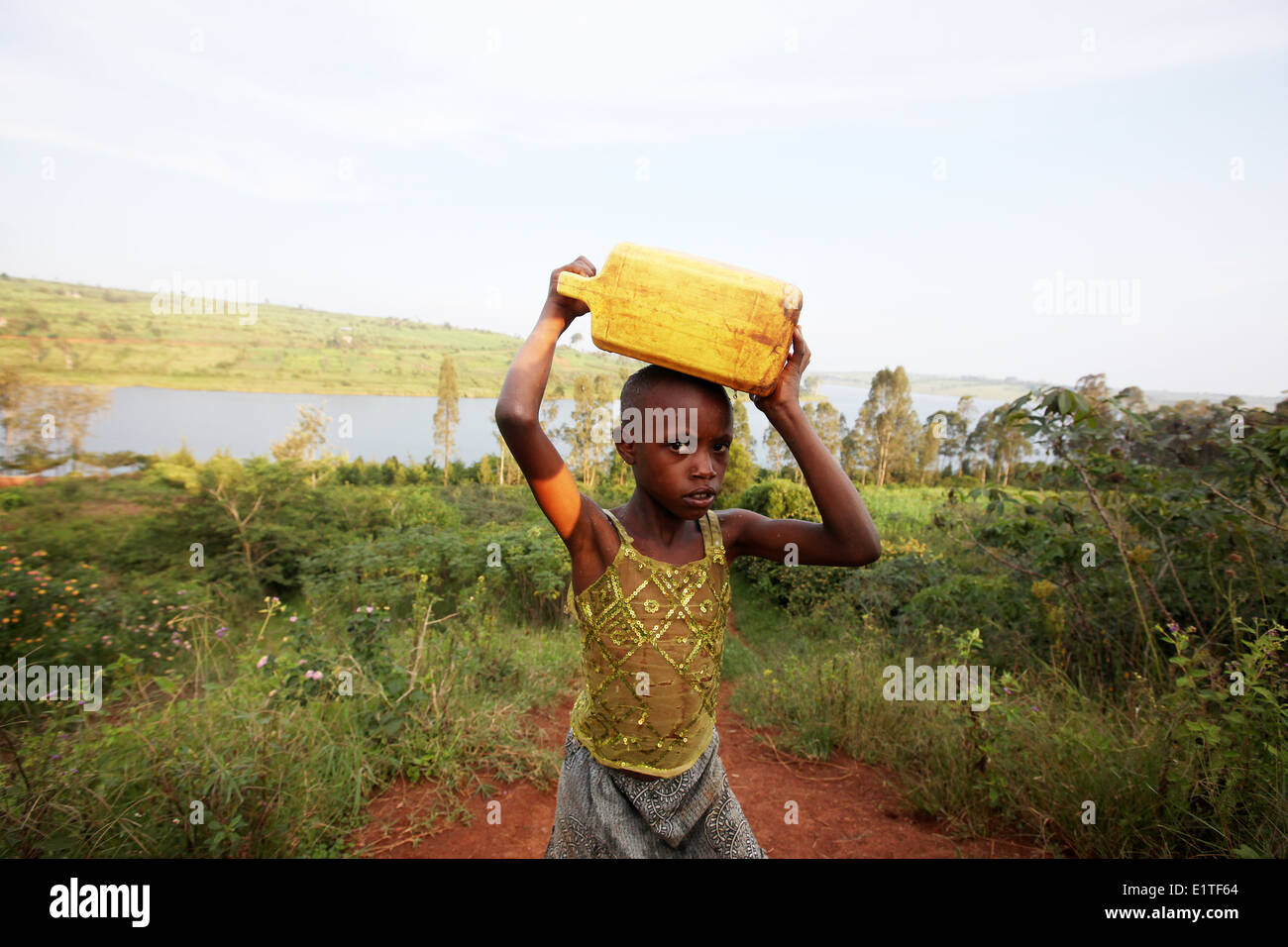 Children collect water in the Nyagatare district of Rwanda, east Africa - Stock Image