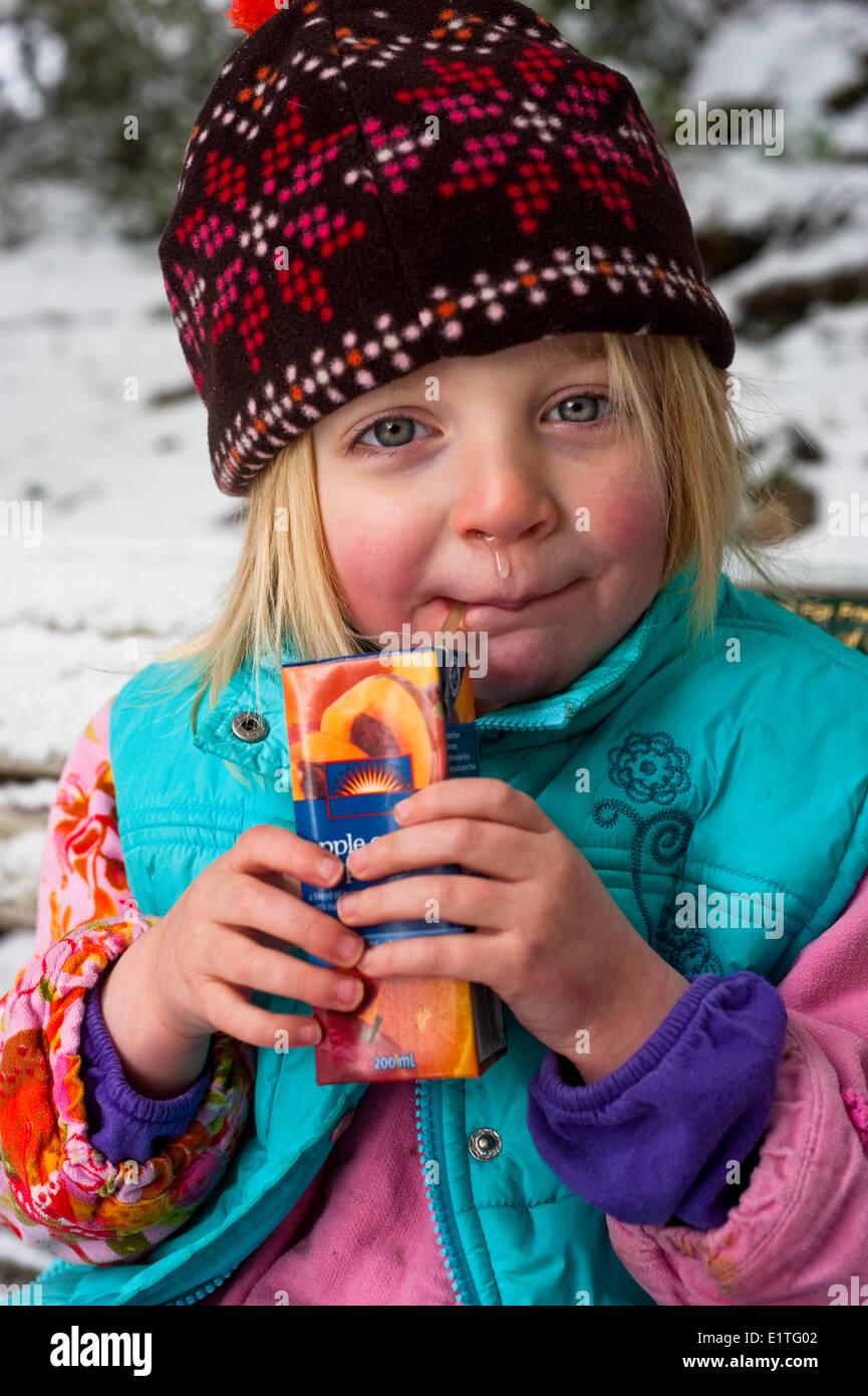 Cold weather induced rhinorrhea in preschool girl - Stock Image