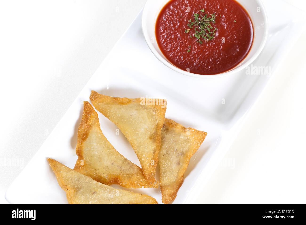 Wontons with Marinara Sauce, Appetizer Stock Photo
