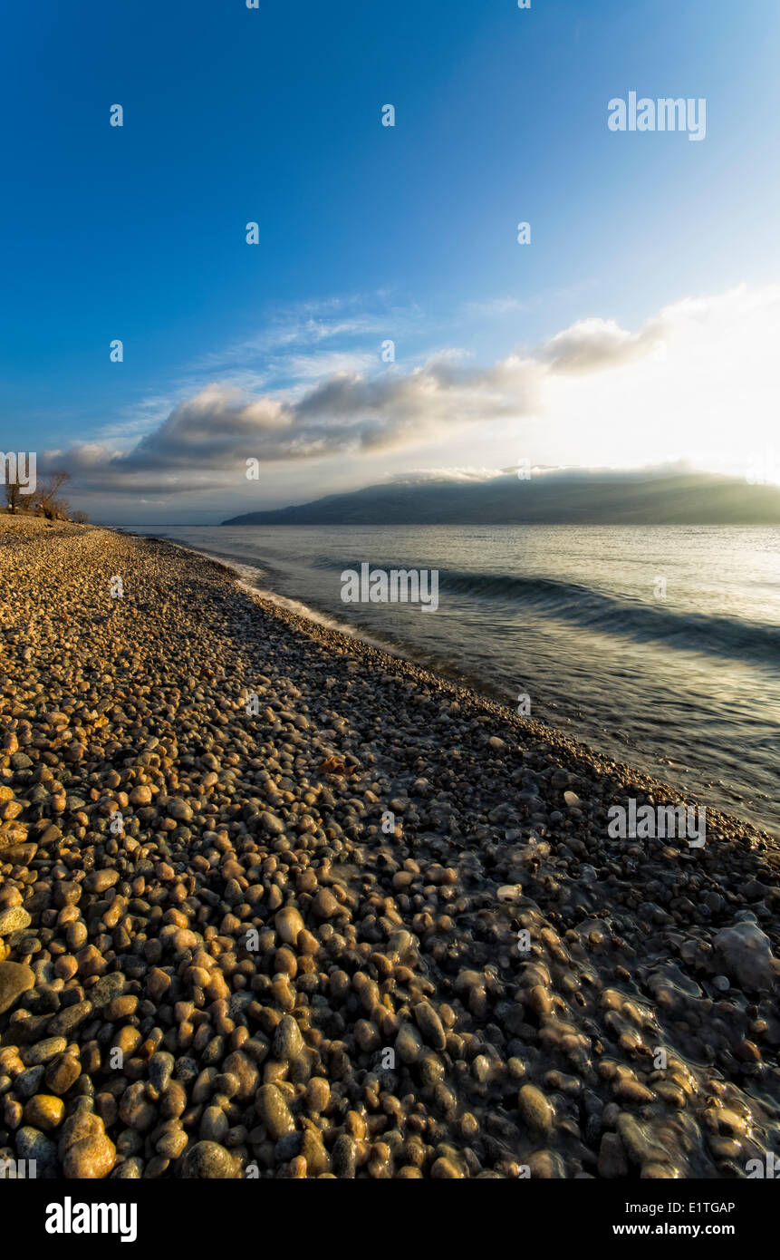Sunrise over Okanagan Lake at Antlers beach in Peachland - Stock Image