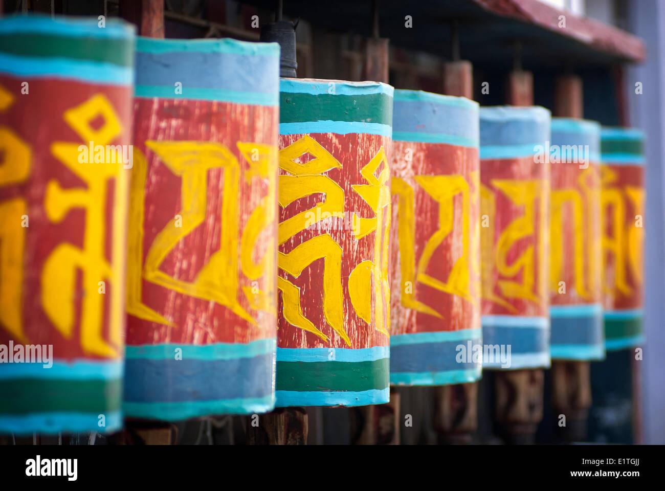 Prayer wheels along the streets of Paro, Bhutan. - Stock Image