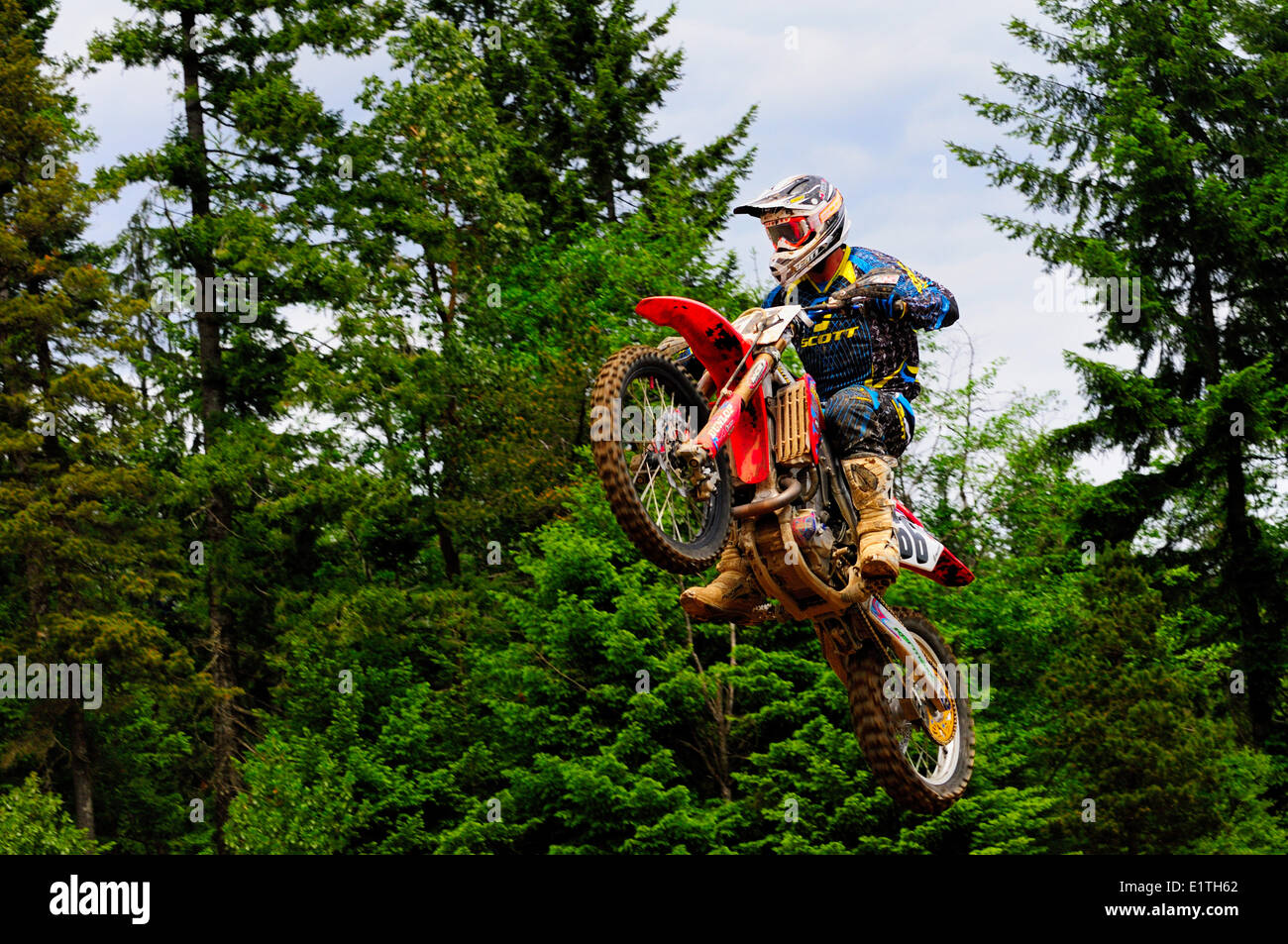 A motocross rider gets some air during a jump at the Monster Energy Motocross Nationals at the Wasteland track in - Stock Image