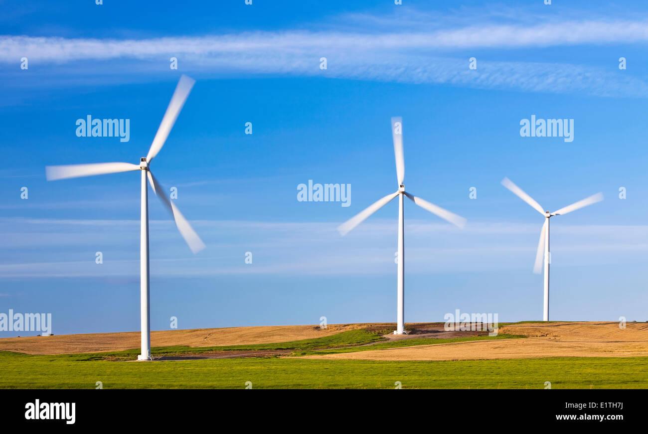 Wind energy turbines, motion blurred blades, St. Leon, Manitoba, Canada - Stock Image