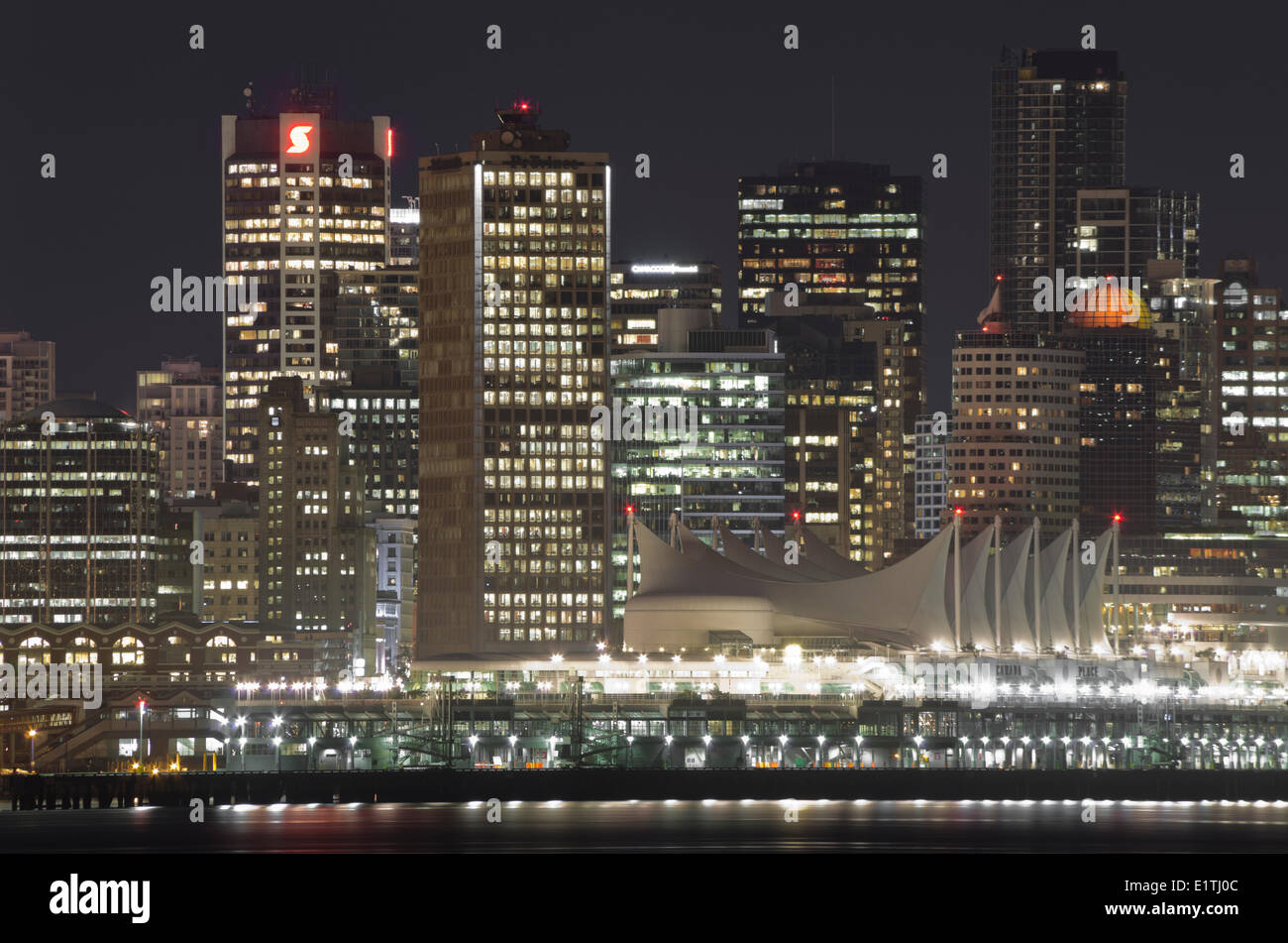 Canada Place and high-rises at night, downtown Vancouver, British Columbia, Canada. - Stock Image