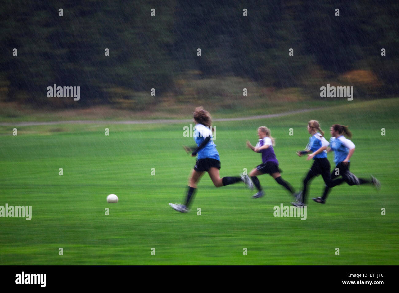 Girl's Soccer, Rain, Team Sports, Physical Activity, Health, Gibson's, Sunshine Coast, B.C., Canada - Stock Image