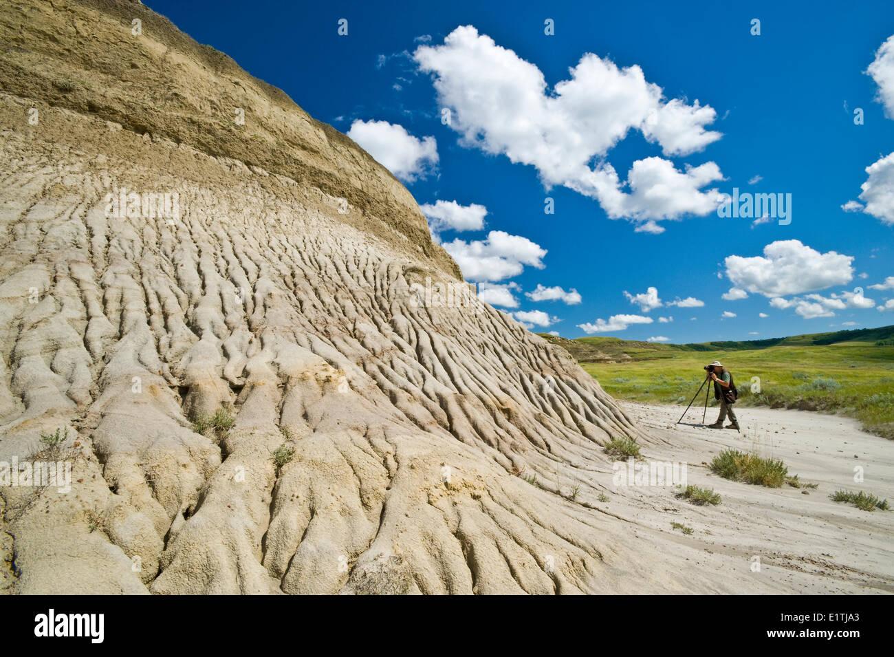 photographing a butte formed by weathering, Killdeer Badlands, East Block, Grasslands National Park, Saskatchewan, Canada - Stock Image