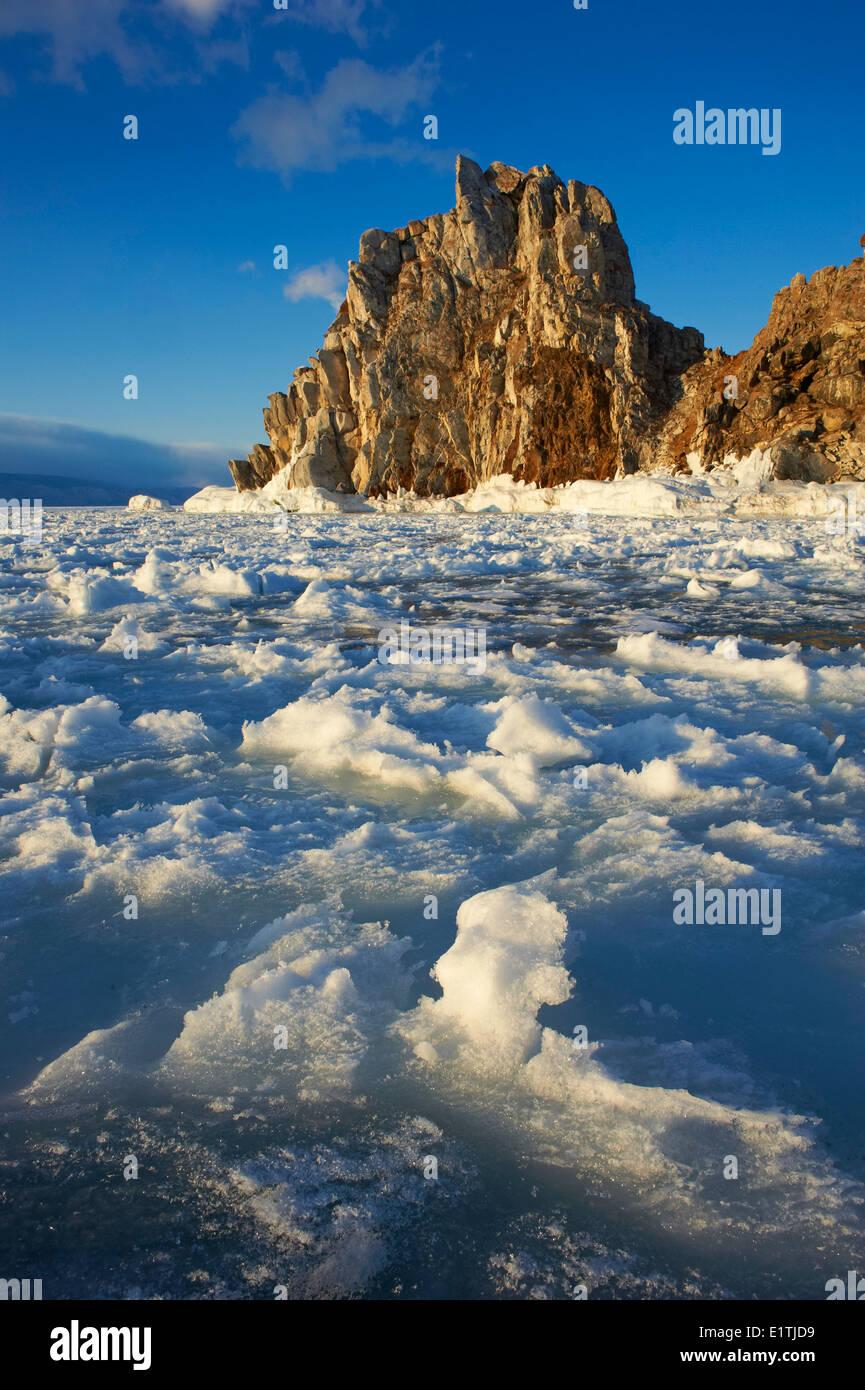 Russia, Siberia, Irkutsk oblast, Baikal lake, Maloe More (little sea), frozen lake during winter, Olkhon island, Shaman rock - Stock Image