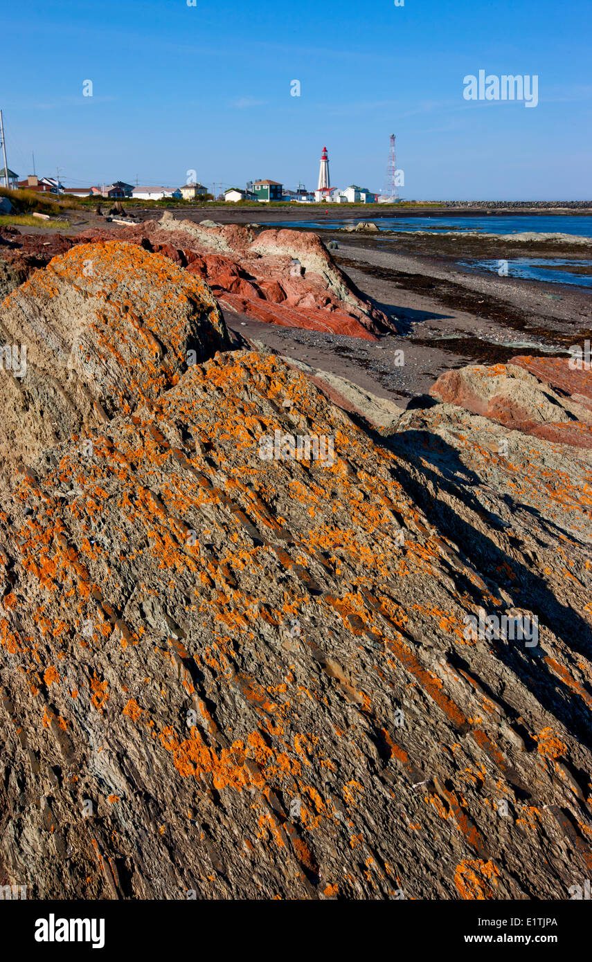 Coastline and lighthouse at Pointe-au-Père Maritime Historic Site,  Quebec, Canada - Stock Image