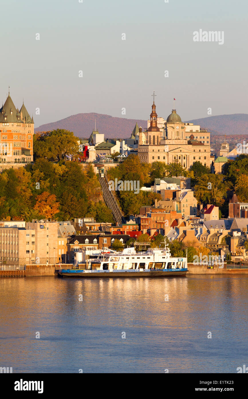 Car ferries docked in front of Old Quebec City at sunrise, Quebec City, Quebec, Canada Stock Photo