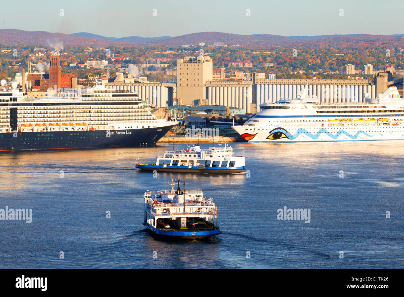 Car ferries crossing the St. Lawrence River in front of cruise ship docked at Quebec City, Quebec, Canada Stock Photo
