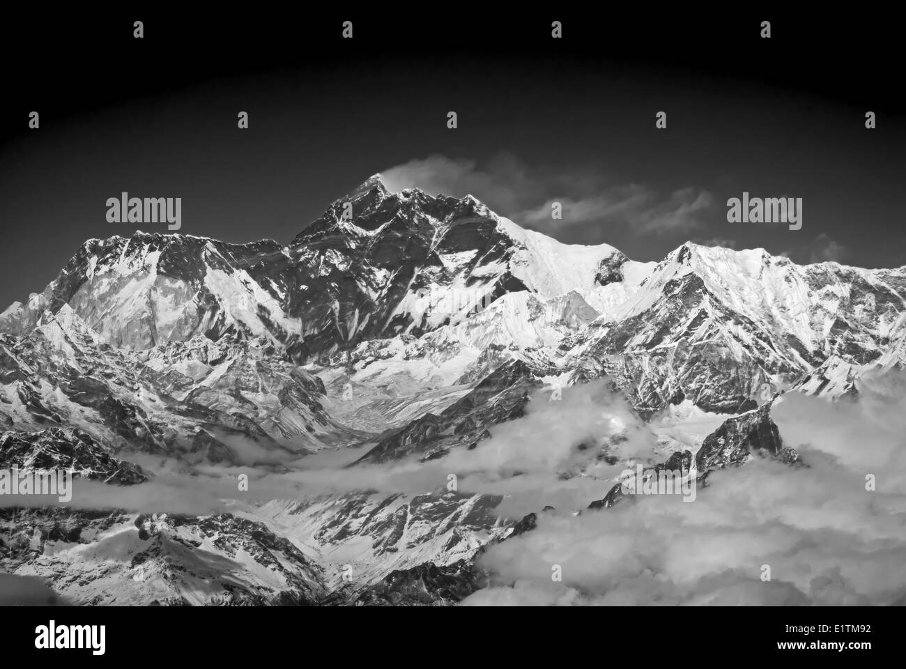 Mt Everest with its customary plume of cloud blowing off the summit, seen from 7000 meters Himalayan Mountains Nepal - Stock Image