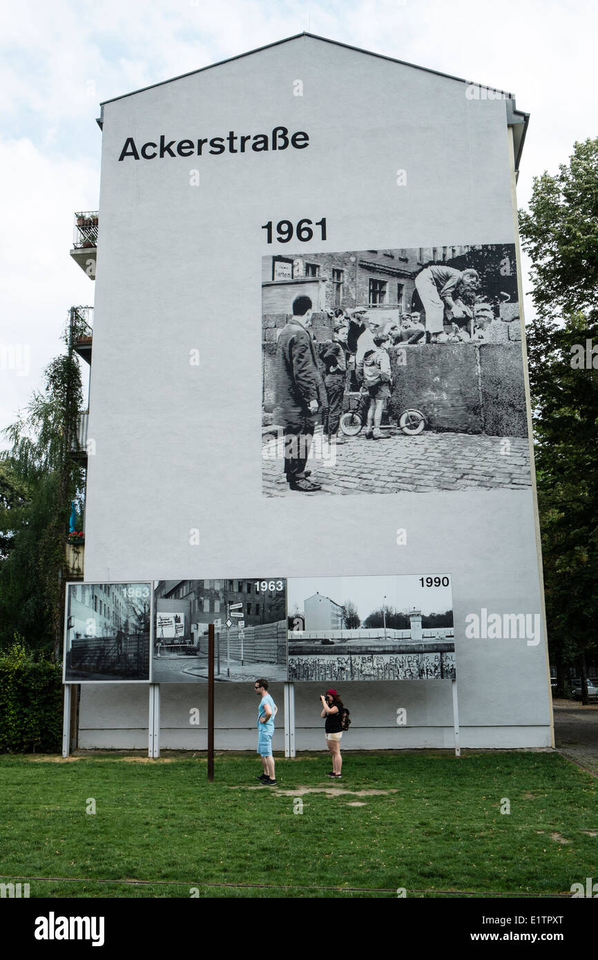 Mural on building as memorial to location of former death strip of Berlin Wall on Bernauer Strasse and Ackerstrasse - Stock Image