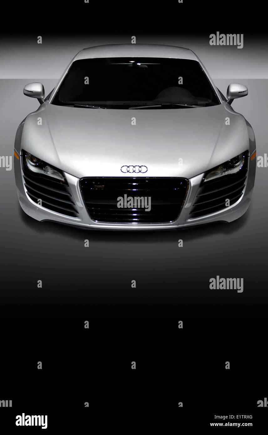 Gray metallic Audi R8 is a mid-engined German sports car Isolated on gray-black background - Stock Image