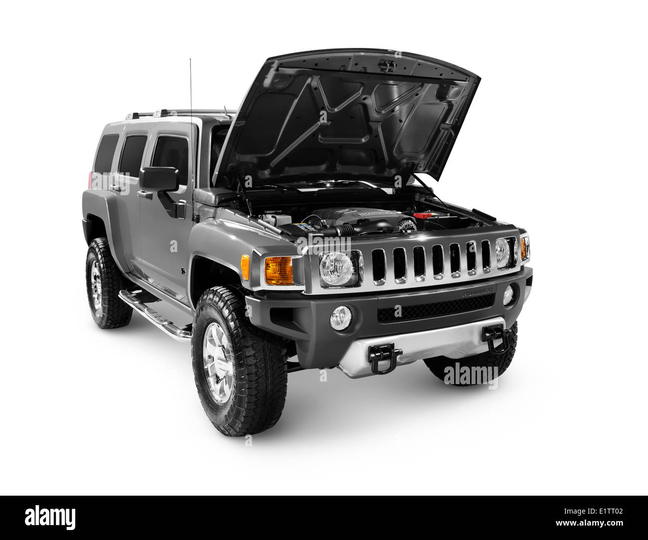 Hummer H3 full-size SUV with open hood revealing engine isolated on white background. - Stock Image