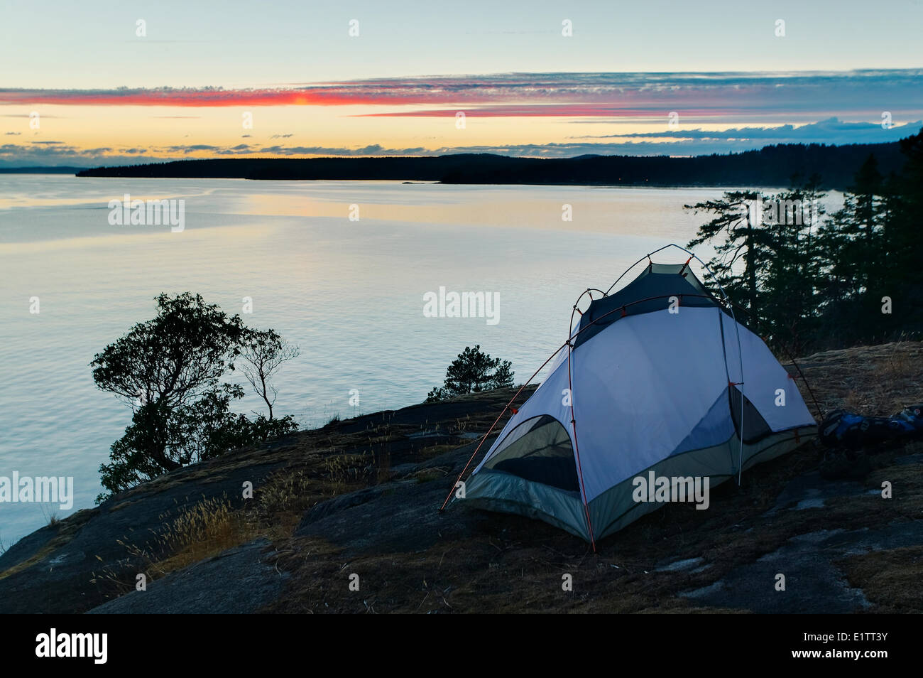 Evening sets over Stillwater Bluffs and Georgia Strait, Powell River, The Sunshine Coast, British Columbia, Canada - Stock Image