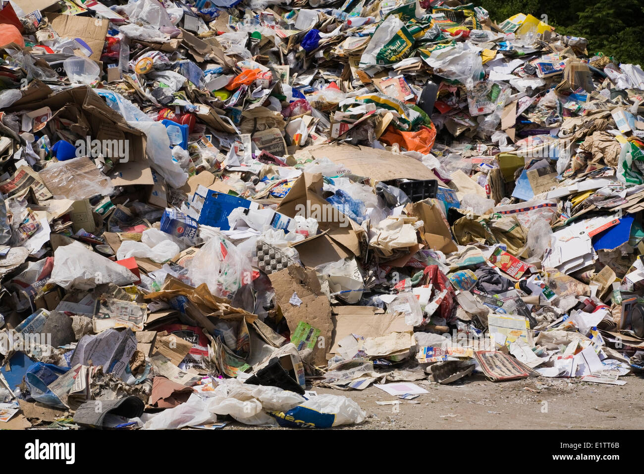 Pile of recyclable materials outdoors at a sorting centre, Quebec, Canada - Stock Image