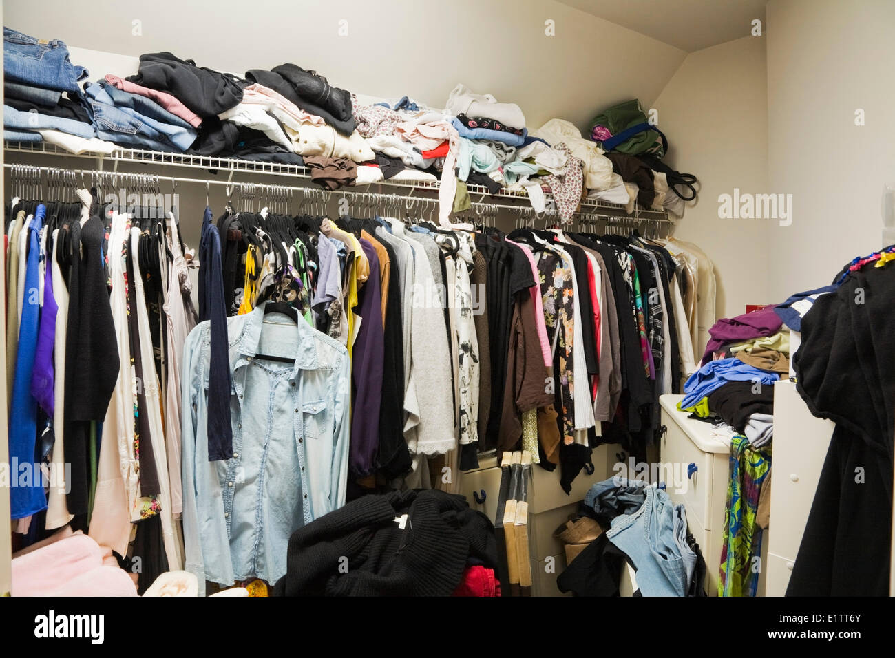 Walk-in closet filled with woman's clothes inside a luxurious cottage style residential home, Montreal, Quebec, - Stock Image