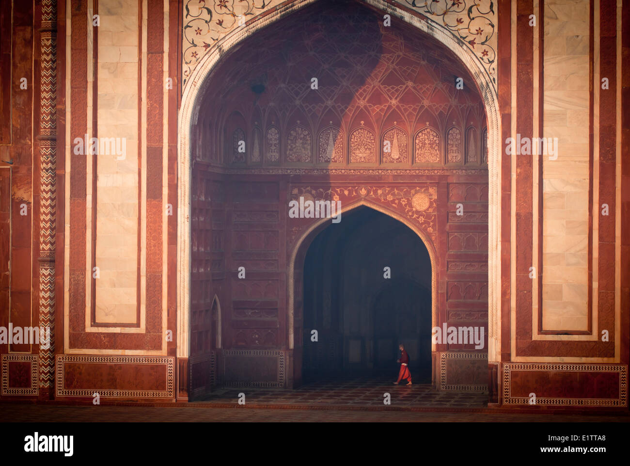 The Mosque to the left of the Taj Mahal shines at sunrise, Agra India - Stock Image