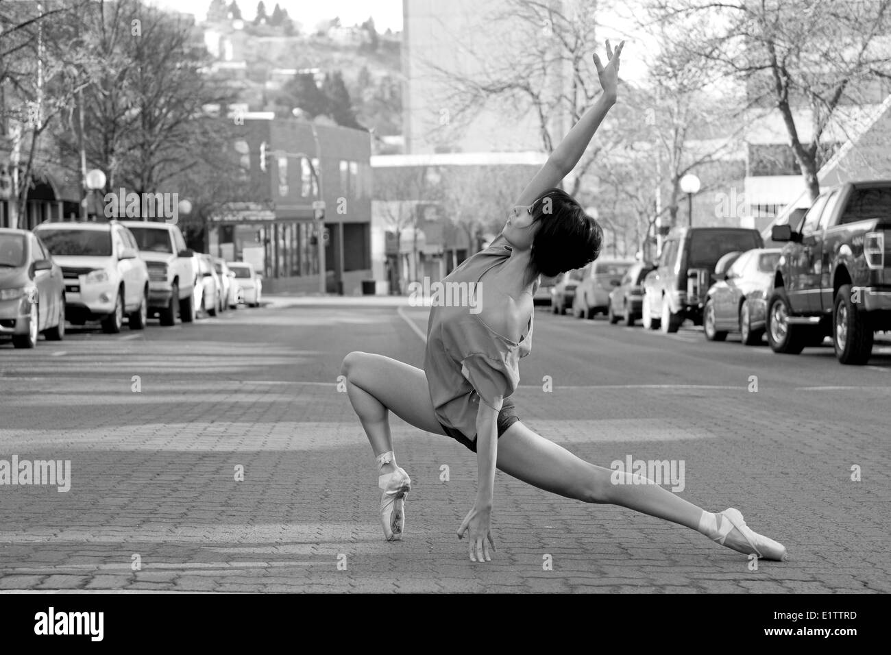 A female ballet dancer in a strength pose in the city of Kamloops, Thompson Okanagan region, British Columbia Canada - Stock Image