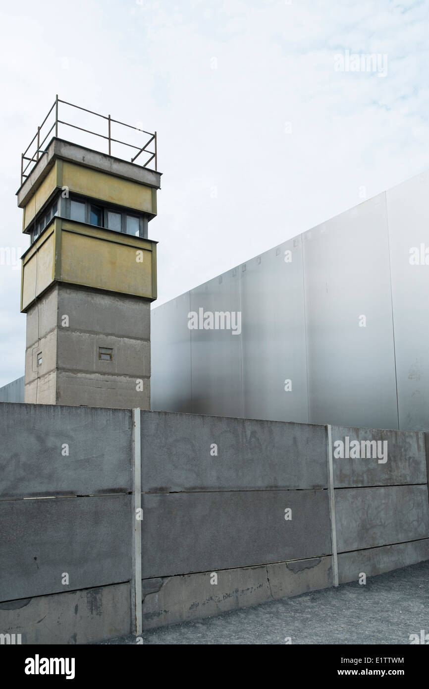 Watchtower and walls at former death strip of Berlin Wall on Bernauer Strasse in Berlin Germany - Stock Image