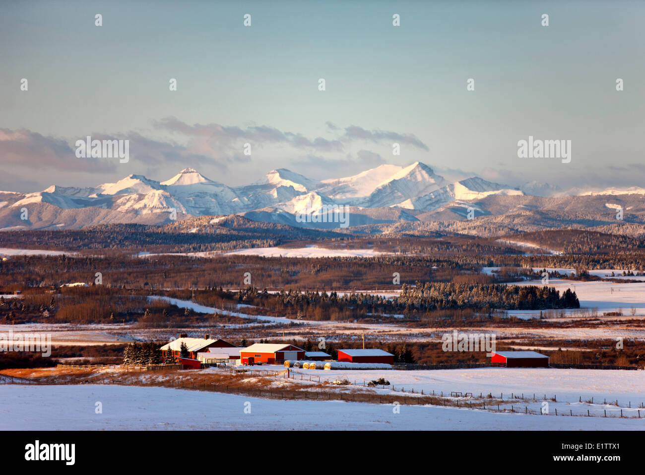 View Rocky Mountains as sun rises, Range Road 33,  Alberta, Canada - Stock Image