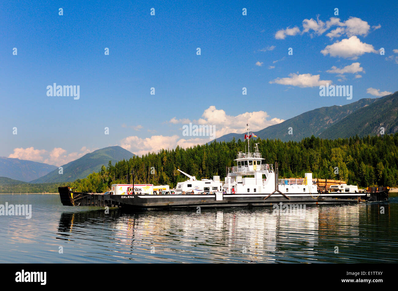 The ferry, D.E.V. Galena, leaves Galena Bay on Upper Arrow Lake on route to Shelter Bay, BC. - Stock Image