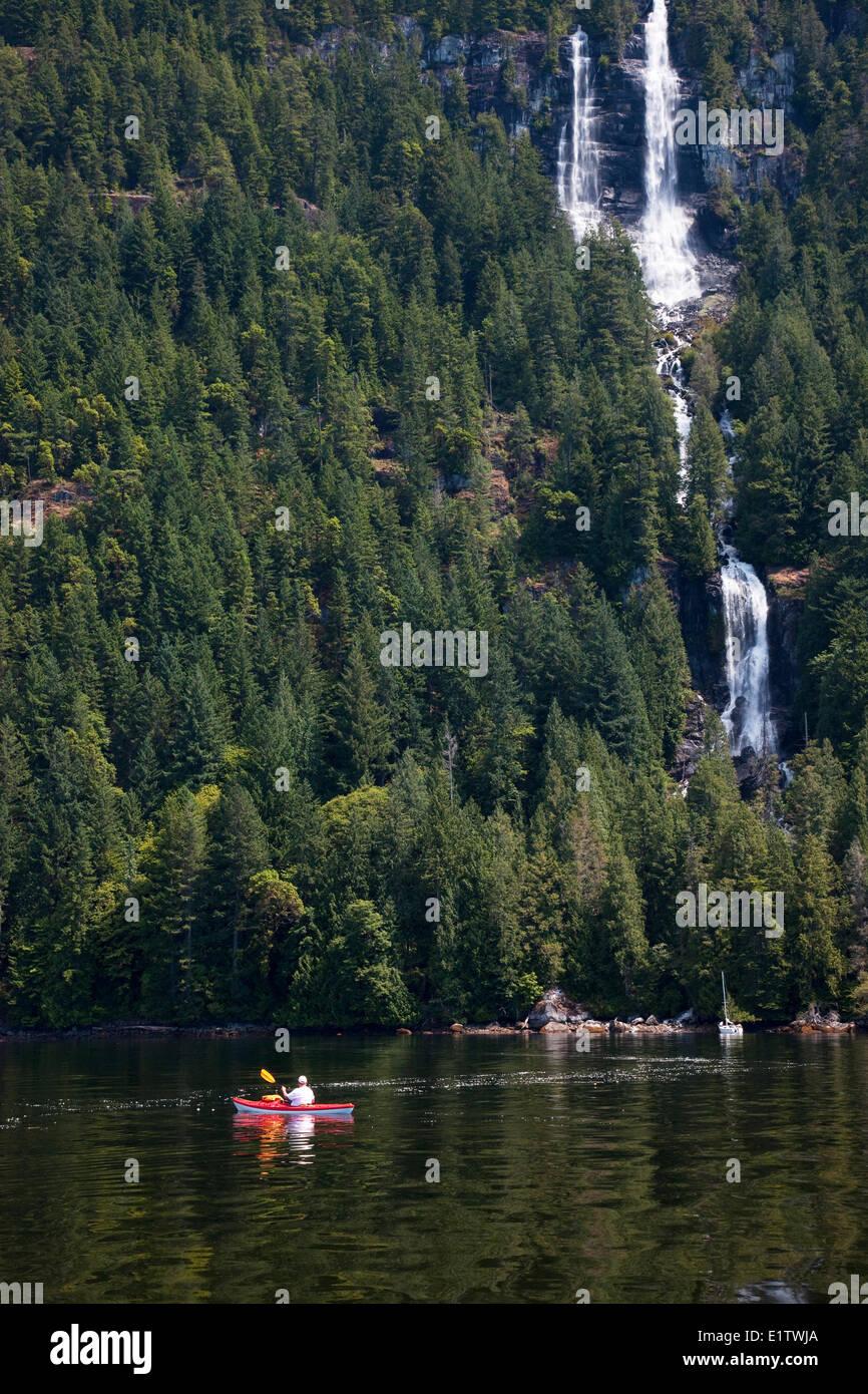 Kayaker, sailboat, Freil Falls, Hotham Sound, Sunshine Coast, British Columbia, Canada - Stock Image
