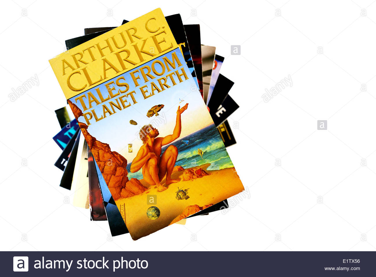 Arthur C Clarke paperback title Tales from Planet Earth, stacked used books, England - Stock Image