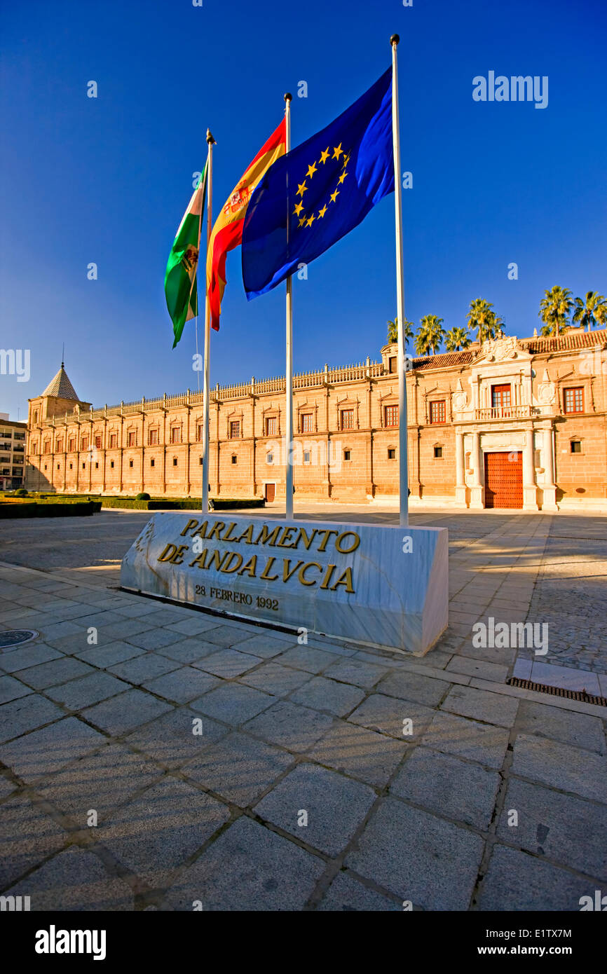 Flags outside the Parlamento de Andalucia (Andalusian Regional Parliament). The Hospital de las Cinco Llagas was - Stock Image