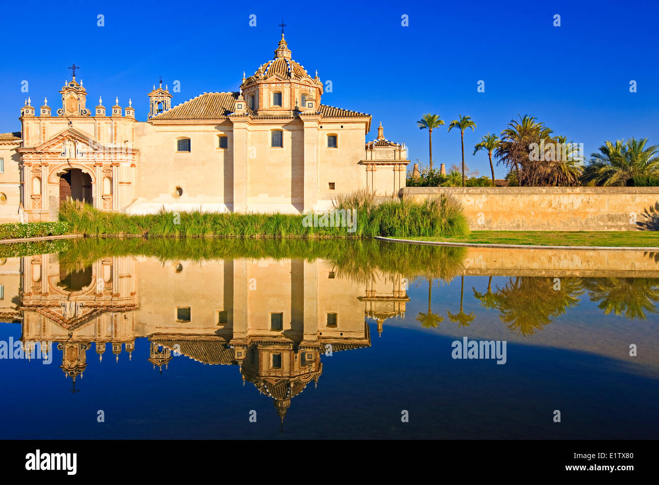Reflections on a pond in the Jardin de la Cartuja the Monasterio de Santa Maria de las Cuevas Monastery Santa Maria - Stock Image
