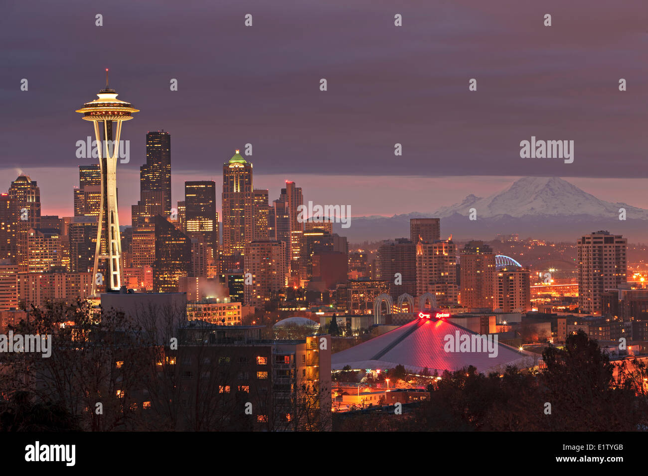 Heavy cloud cover during sunrise above the city of Seattle and the famous Space Needle landmark, Washington State, - Stock Image