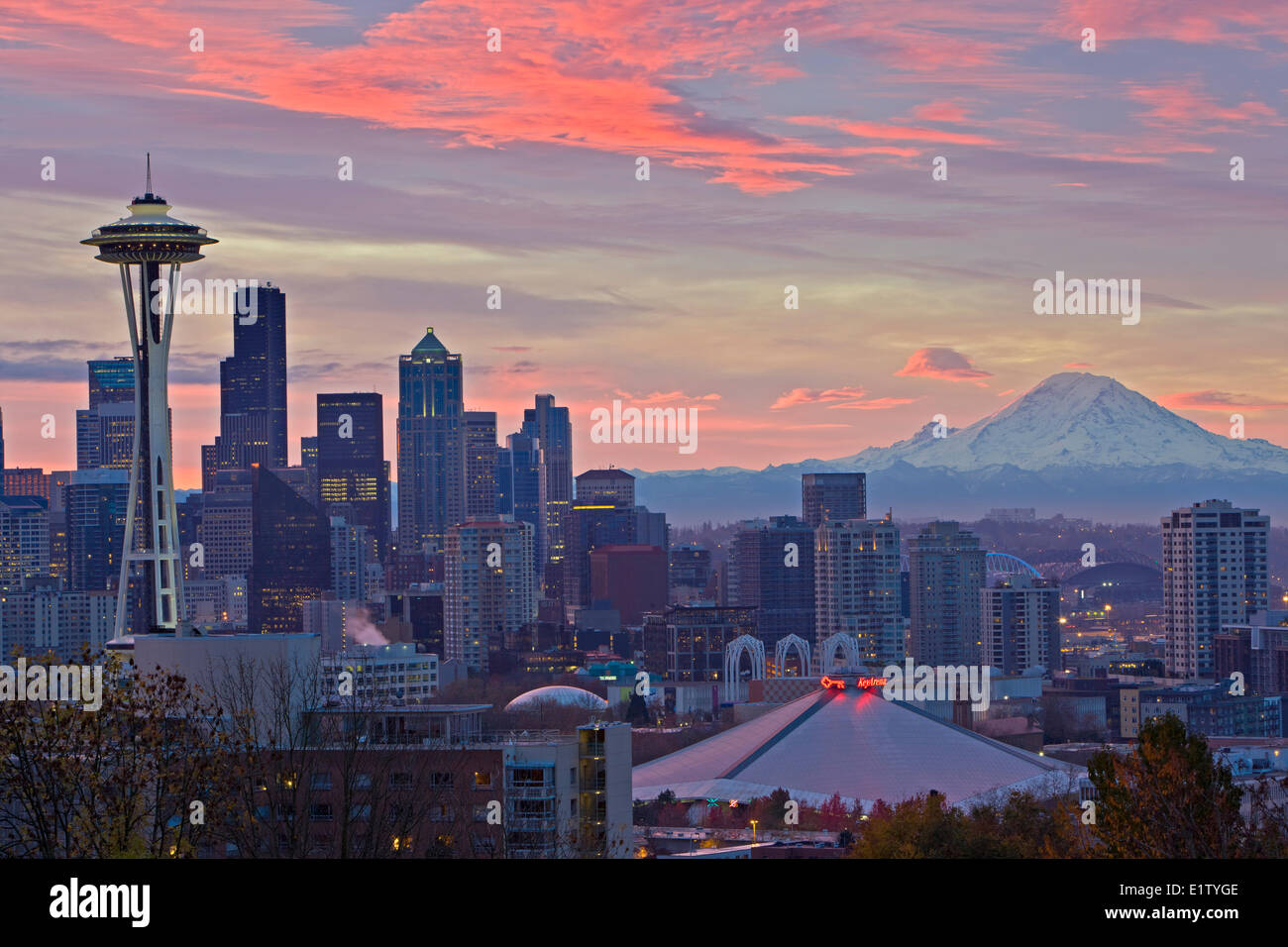 Colorful clouds during sunrise above the city of Seattle and the famous Space Needle landmark, Washington State, Stock Photo