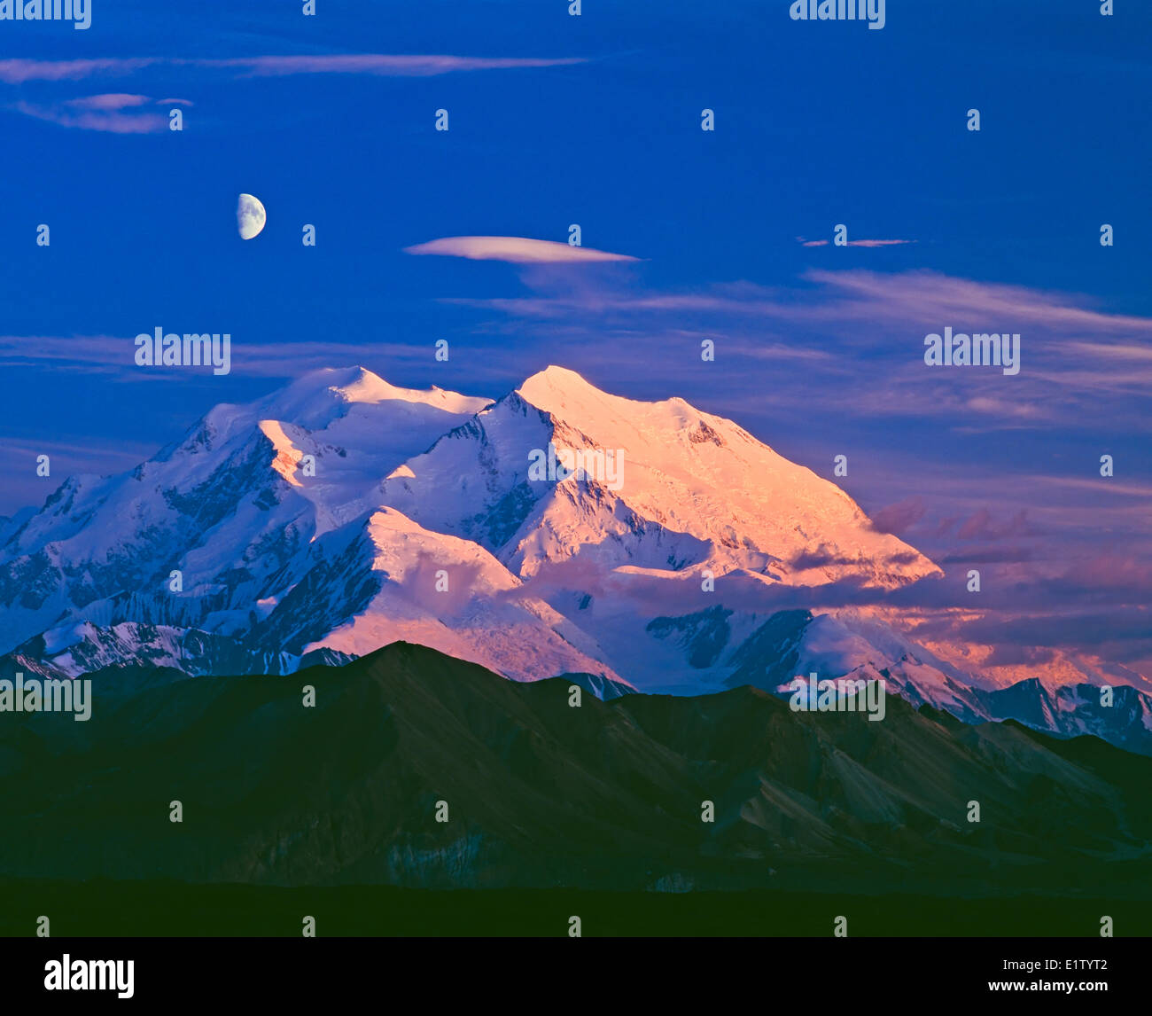 Mount McKinley (Denali) with a half moon at dawn and dusk, twilight, in Denali National Park and Preserve, Alaska, - Stock Image
