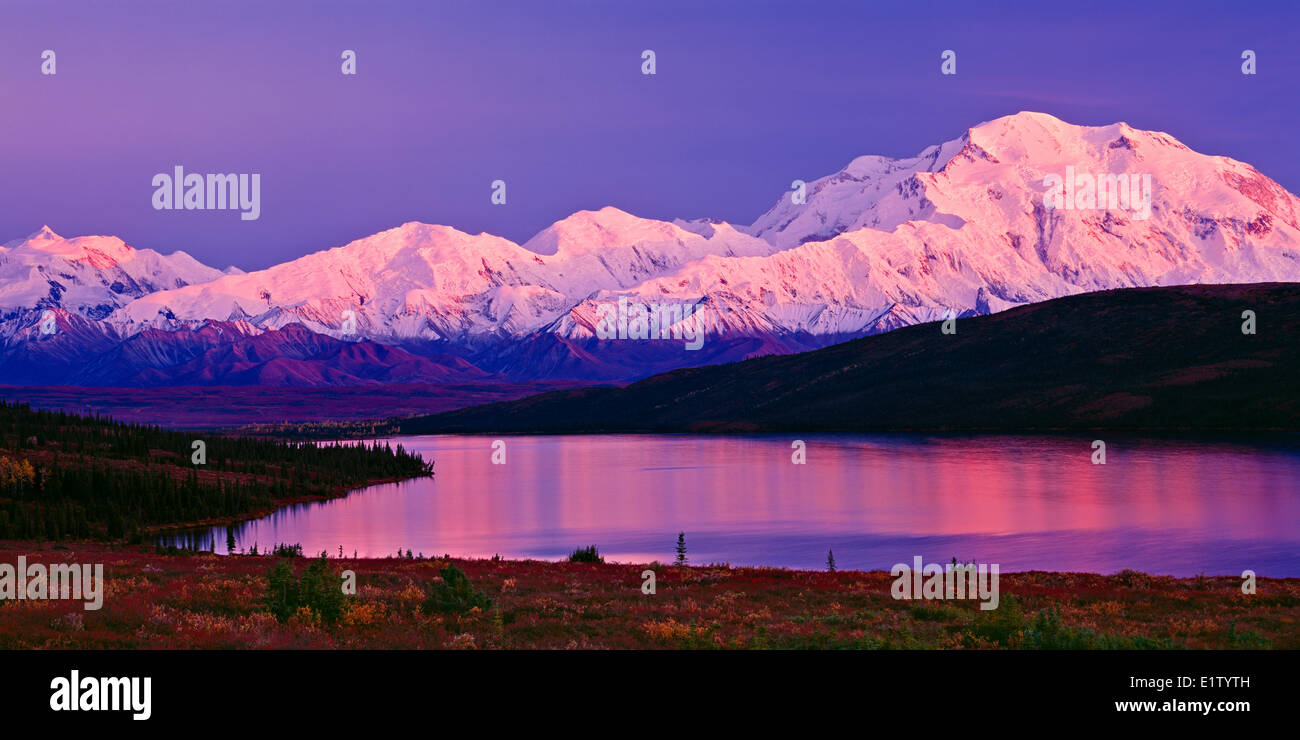 Alpenglow on Mount Mc Kinley (9194m) on a brisk fall morning with beautiful color reflections in Wonder Lake photographed - Stock Image