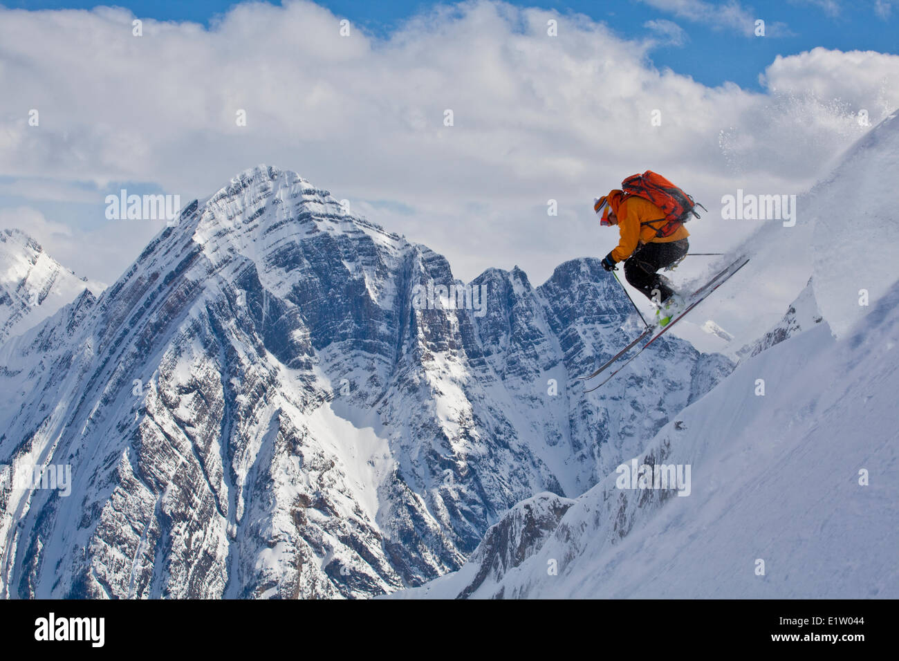 A male backcountry skier airs a pillow with classic canadian rockies scenery as a backdrop. Icefall Lodge, Golden, - Stock Image