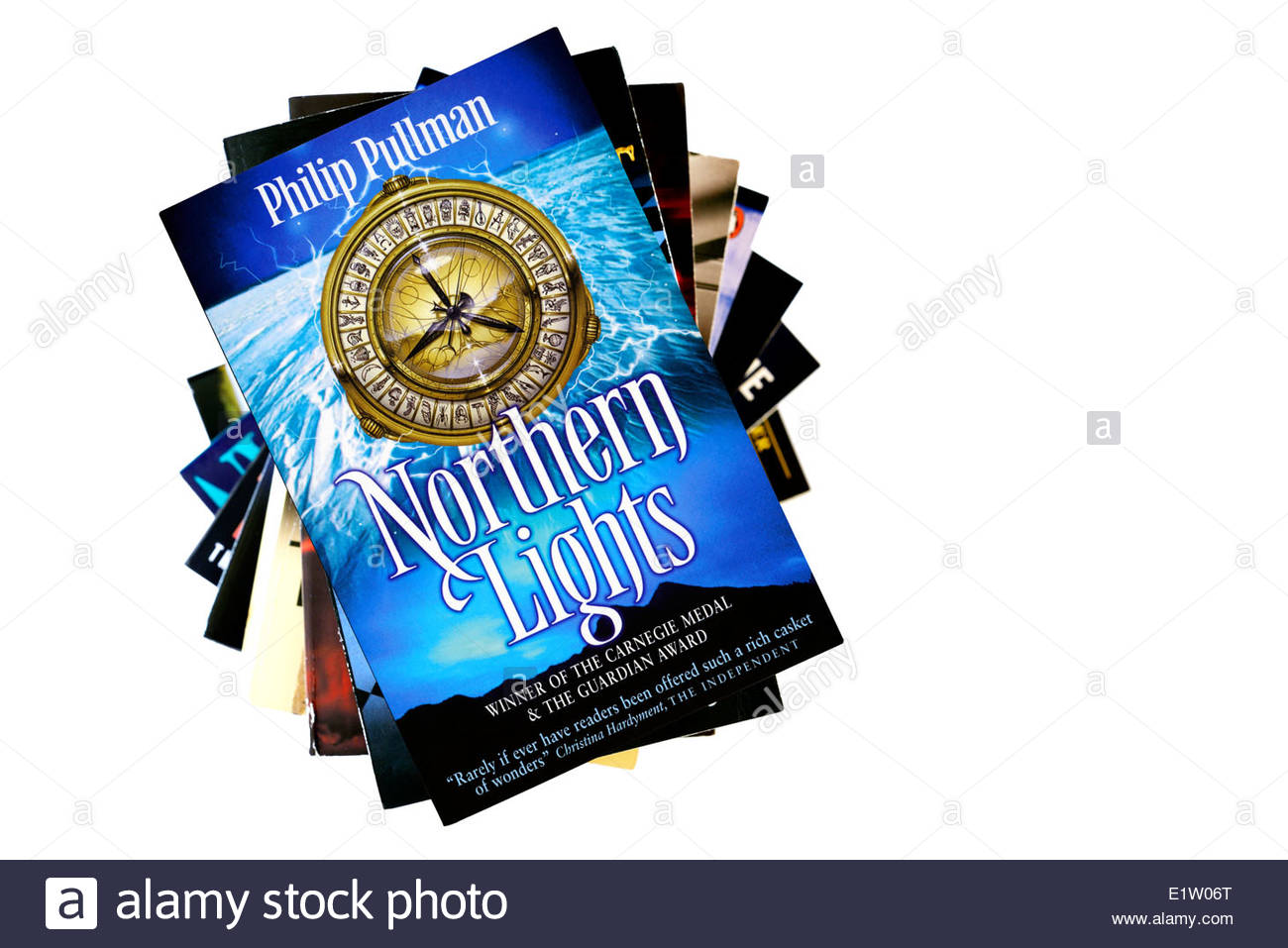 Phillip Pullman, Northern Lights, paperback title stacked used books, England - Stock Image