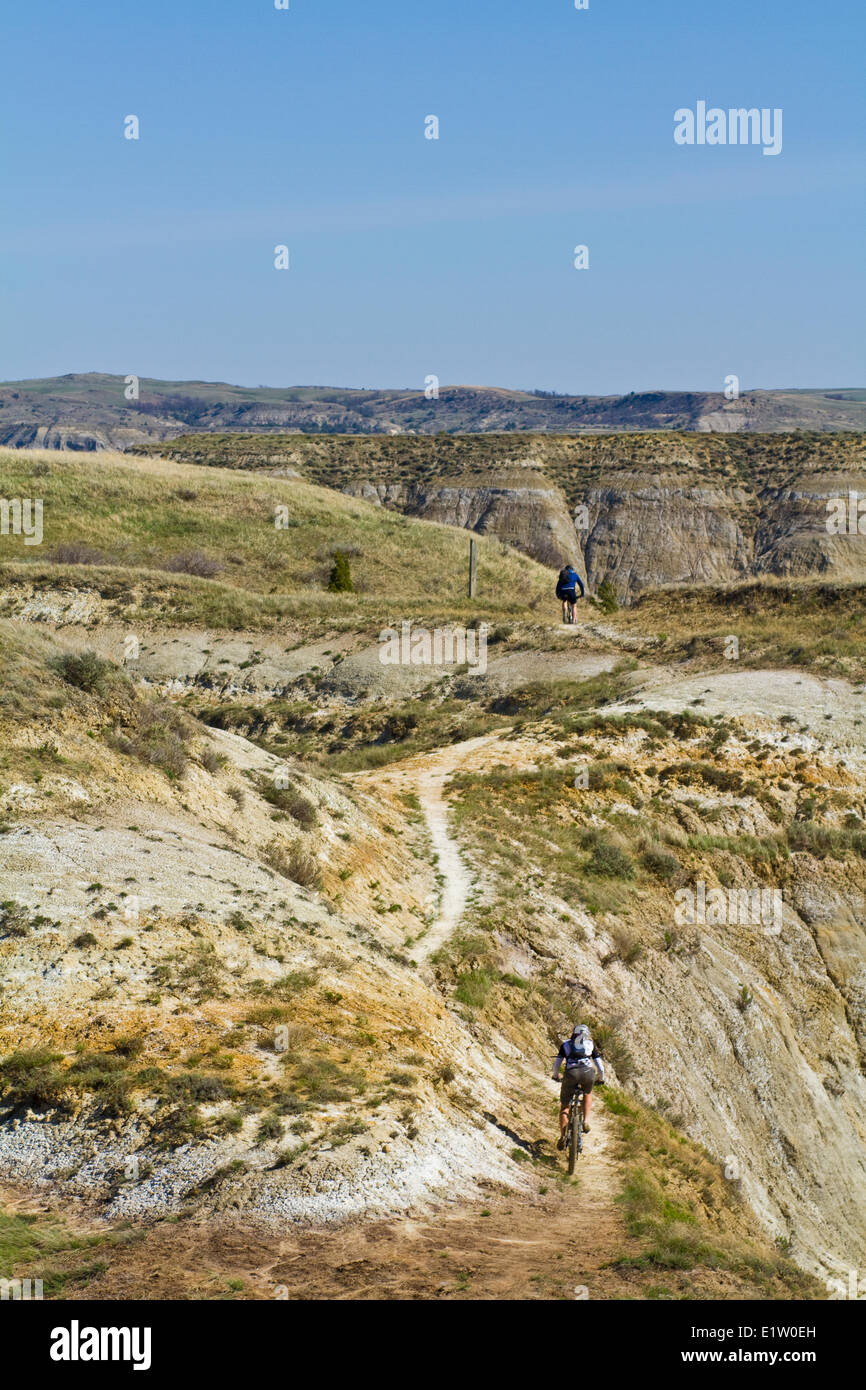 A middle aged man mountain bikes the  single track of the Maah Daah Hey Trail, North Dakota - Stock Image