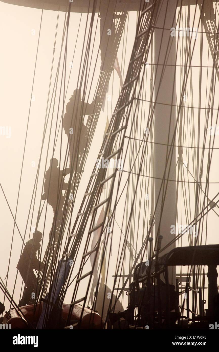 Sailors climb rigging on INS Tarangini in Halifax Harbour during 2007 Tall Ships festival in Halifax, Nova Scotia. - Stock Image