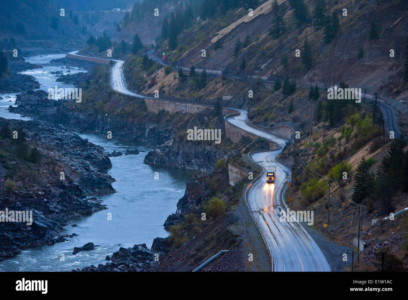 Transport truck on Highway 1 beside the Thompson river. - Stock Image