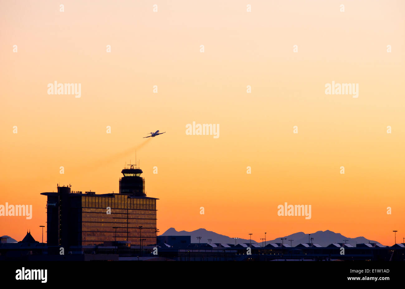 Control tower and outbound aircraft, Vancouver International airport. - Stock Image