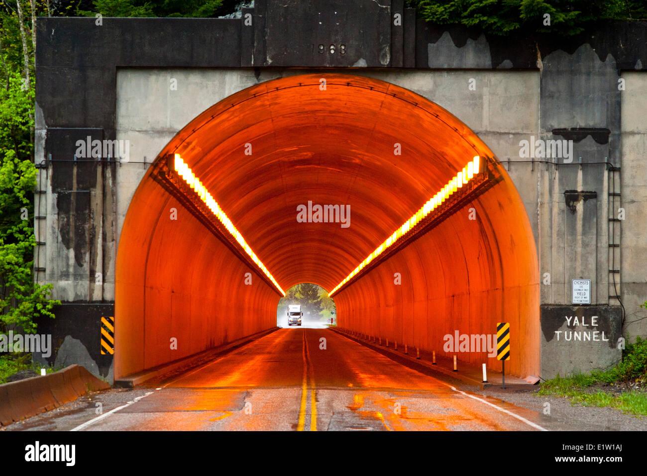 Sodium vapor lights used to illuminate a tunnel. - Stock Image